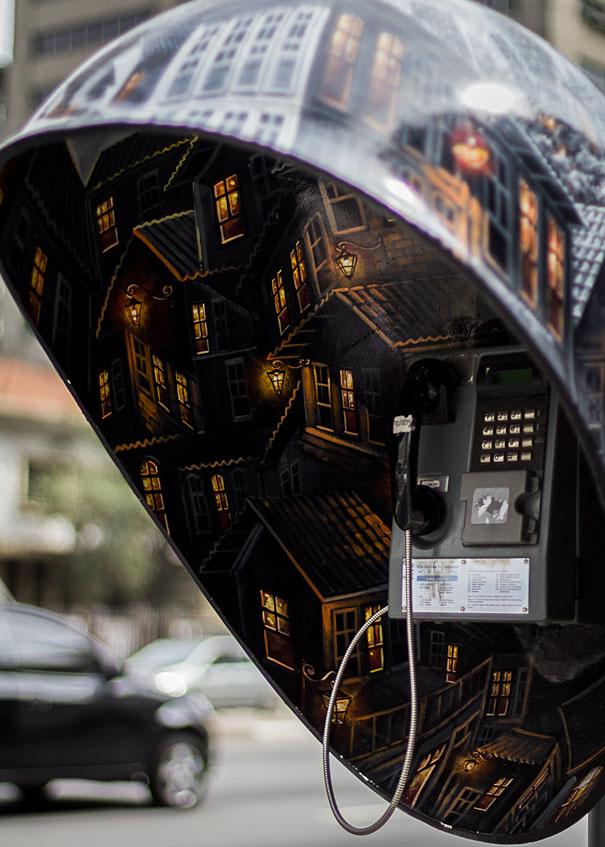 街头电话亭涂鸦之城市灯火