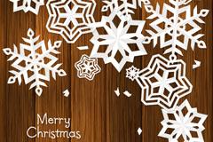 木板上的白色雪花贺卡矢量素材