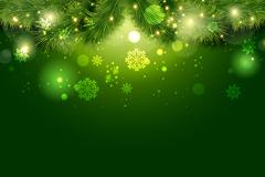 绿色松枝与雪花背景矢量素材