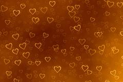 橙色爱心光晕咖啡色背景矢量素材