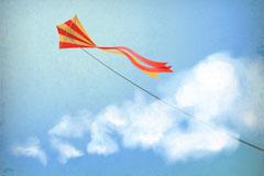 飘扬在天空中的风筝矢量素材