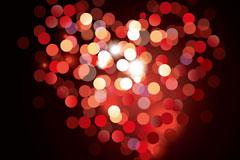红色光晕组成的爱心背景矢量素材