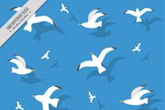 飞翔的白色海鸥无缝背景矢量图