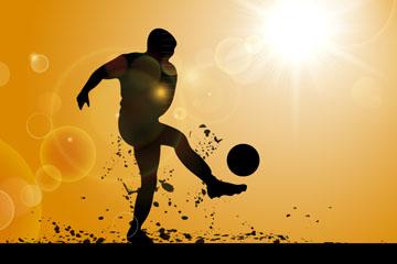 太阳下踢足球的男子剪影矢量图