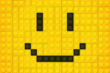 创意乐高积木拼成的笑脸矢量图