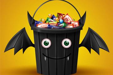 卡通装满糖果的万圣节蝙蝠桶矢量图