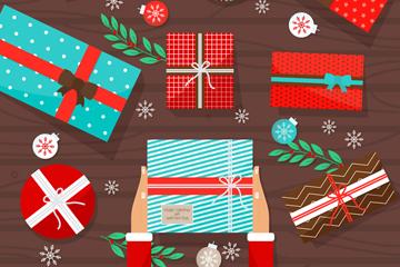 彩色铺满桌面的圣诞礼物矢量素材