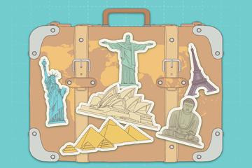 彩绘贴满名胜贴纸的旅行箱矢量图