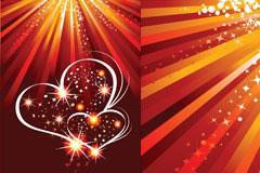 情人节闪光心形与光芒矢量素材